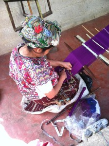 Woman making a wallet in Chajul